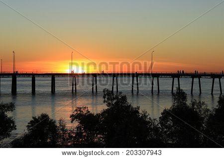 sun setting behind the wharf in Derby, Western Australia.