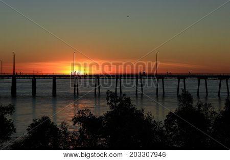 Sun setting hehind the wharf in Derby, Western Australia
