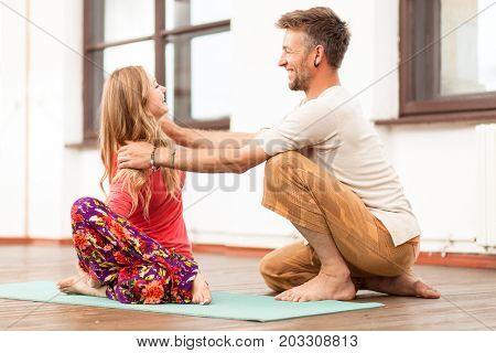 Yoga instructor teaching a woman