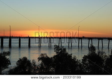 sun setting behind the wharf at Derby, Western Australia