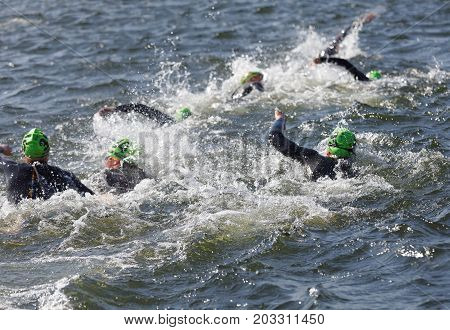STOCKHOLM - AUG 26 2017: Chaos of swimming female competitors fighting water squirting in the Women's ITU World Triathlon series event August 22 2017 in Stockholm Sweden