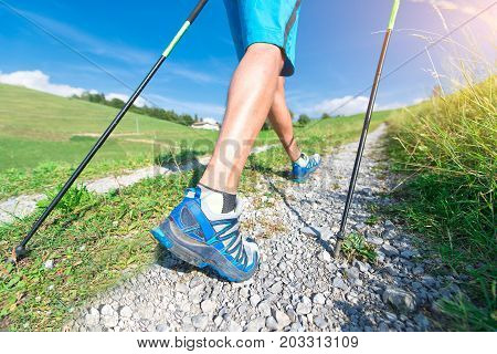 Nordic Walking on dirt road in summer