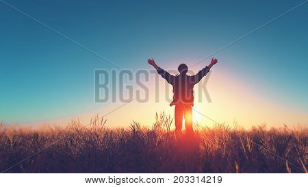 Man with his hands raised in the sun on a field with dry grass. This is a 3d render illustration