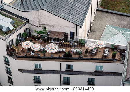 Munich, Germany - August 3, 2017: Scenic panoramic high angle view of historical city centre of Munich from the tower of the church of St Peter. Penthouse