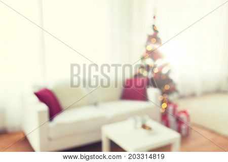 christmas, holidays, backdrop and interior concept - blurred living room with christmas tree background