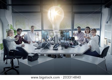 startup, technology and people concept - business team with tablet pc and computers showing thumbs up at office
