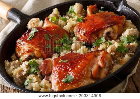 Baked Chicken Thighs With Quinoa And Mushrooms Close Up. Horizontal