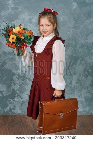 Schoolgirl With School Knapsack And Flowers