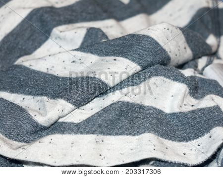 A creased background of striped black and white fabric clothing texture; England; UK
