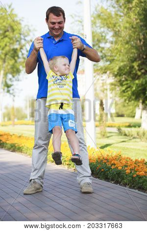 Young happy Father with four year old son in summer park