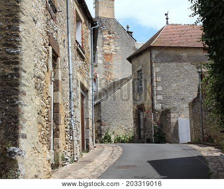FRESNAY-SUR-SARTHE, FRANCE, JULY 15 2017: View of the streets of the quaint historic old town of Fresnay-sur-Sarthe in Western France. Fresnay is a less well known tourist destination in Pay de Loire.