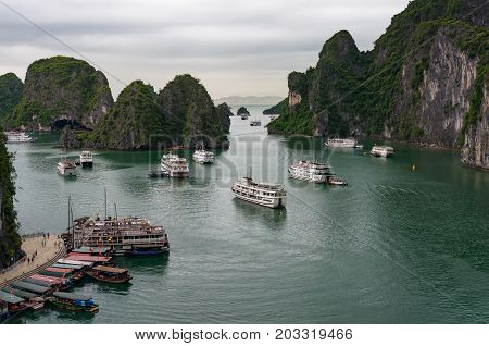 Halong Bay With Cruise Ships And Boats Near Surprise Cave