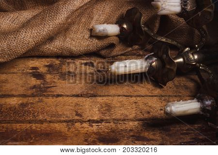 Candle holder with candles on the wooden background