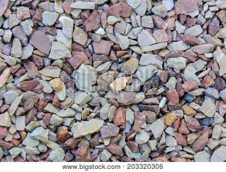 Fine natural stone mulch for landscaping texture background.