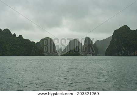 Dramatic Karst Islands Of Halong Bay On Mist