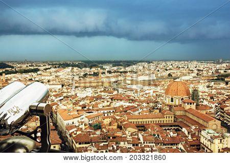 Storm over the Florence city Tuscany Italy. Retro photo filter. Urban scene.