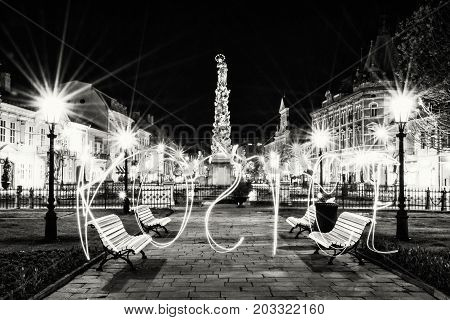 Plague column in Kosice city Slovak republic. Night scene. Writing with light - art technique. Architectural scene. Black and white photo.