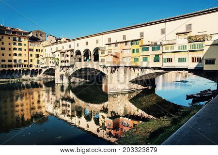 Beautiful Ponte Vecchio is mirroring in the river Arno Florence Tuscany Italy. Travel destination. Beauty photo filter.