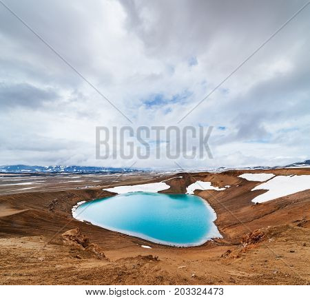 Caldera volcano with turquoise water. Lake Krafla, a tourist attraction of Iceland. Geothermal valley Leirhnjukur