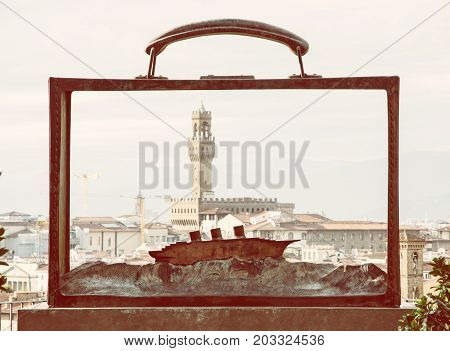View of the Palazzo Vecchio through the metal frame with the boat Florence Tuscany Italy. Travel destination. Yellow photo filter.