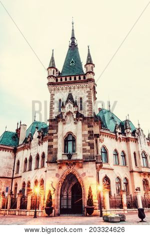 Beautiful Jakab's palace in Kosice city Slovak republic. Evening photo. Architectural scene. Retro photo filter.