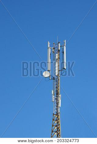 Close up on Cellular transmitter on blue sky background