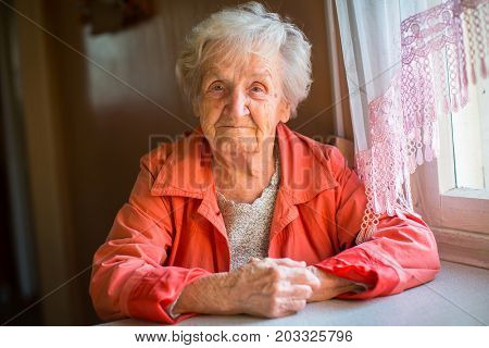 Portrait of stern elderly women.