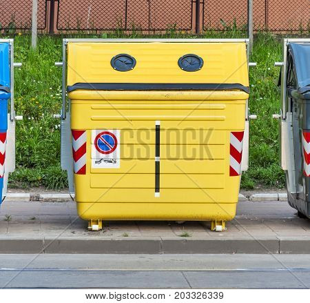 Yellow recycling container on the street close