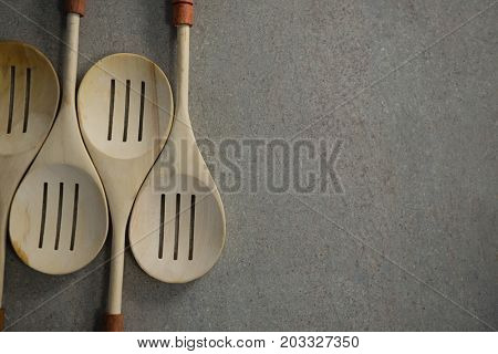 Overhead view of spatulas arranged side by side on table