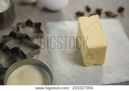 High angle view of butter with pastry cutters on table
