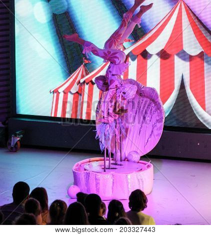Yalta, Crimea - 11 July, Synchronous acrobatics on stage, 11 July, 2017. Performance of young artists on the stage of the hotel Yalta Intourist .