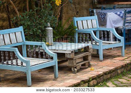 July 20 2017 Villa de Leyva Colombia: rustic outdoor patio furniture made of reclaimed wood