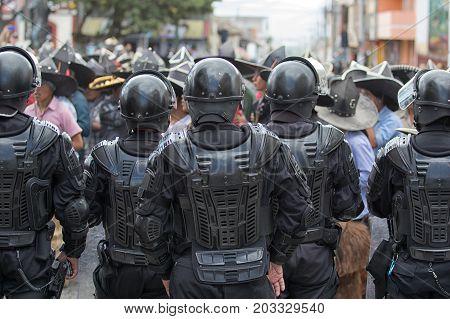 June 29 2017 Cotacachi Ecuador: riot police on guard at Inti Raymi summer solstice celebration