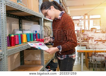 Seriously Successful Designer Woman Choosing Red