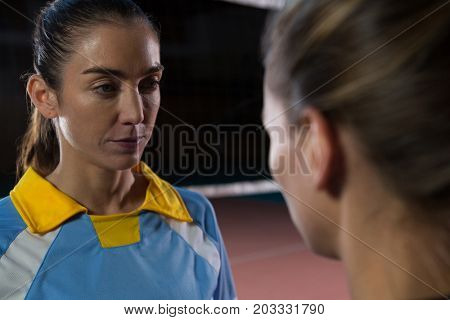 Female volleyball player looking teammate at court