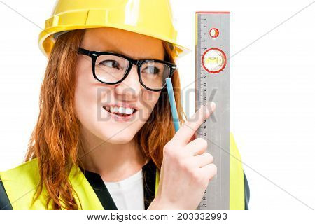 Beautiful Woman Builder In Helmet With Ruler On White Background Isolated