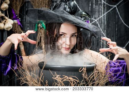 A Brunette With Brown Eyes In The Image Of A Witch Above A Cauldron