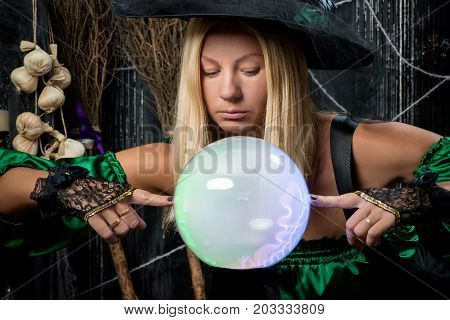 The witch looks into his magic ball and tries to see the future