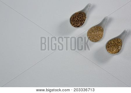 Various breakfast in spoon on white background