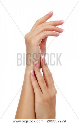 Closeup shot of woman's hands with french manicure and clean and soft skin over a white background, isolated