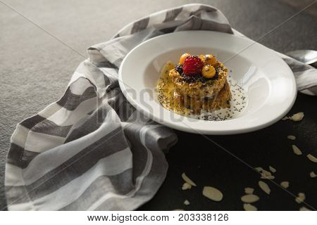Plate of breakfast cereals with fruits in bowl