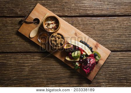 Breakfast and fruits on served on chopping board