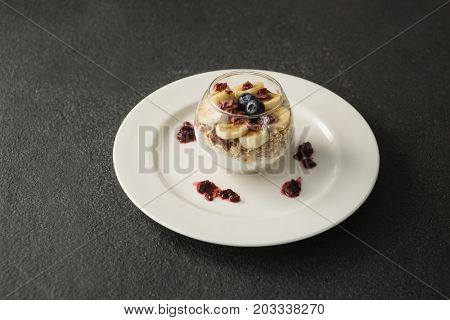 Close-up of fruit cereal in jar on concrete background