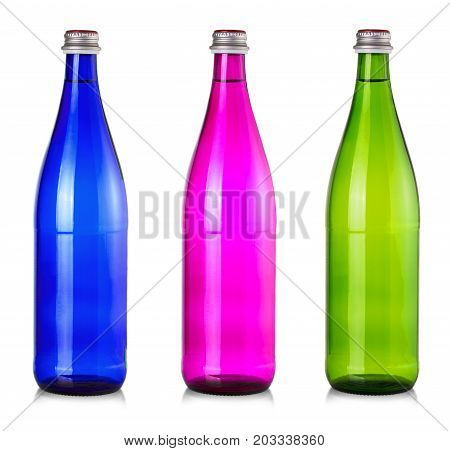 Set of colored bottles of water mineral isolated on white background