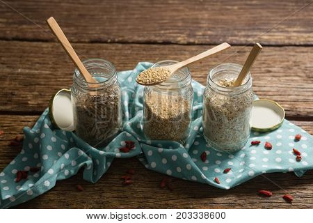 Close-up of three jars with various grains