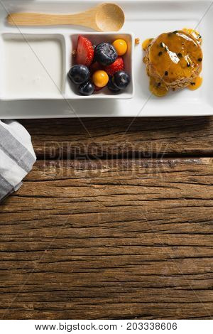Healthy breakfast in serving plate on a wooden table