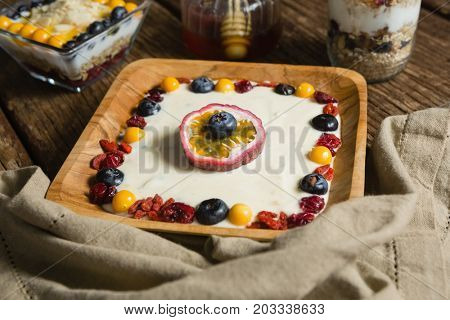 Close-up of various fruit cereals on a wooden table