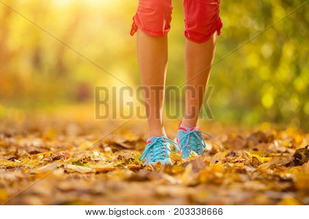 Detail of young woman leg during autumn running axercise. Lifestyle and sport photo of healthy style. Outdoor and nature fitness.