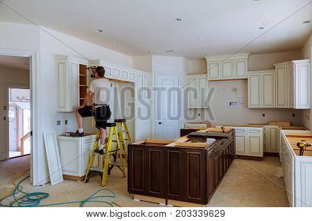 Installation Of Kitchen Cabinet.