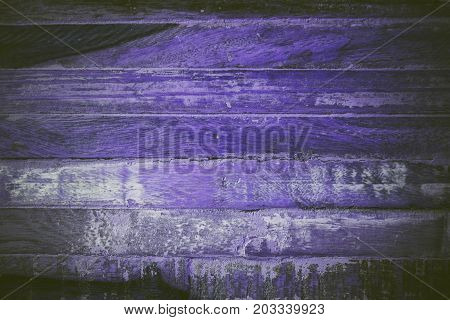 Purple wood texture and background. Close up view of purple wood texture and background. Abstract purple background and texture for designers. Rustic wood. Texture of handmade vintage purple table.